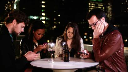 four-people-at-the-table-with-phones